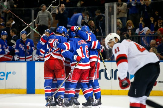 Mar 9, 2019; New York, NY, USA;  The New York Rangers celebrate after a goal against the New Jersey Devils during the second period at Madison Square Garden.
