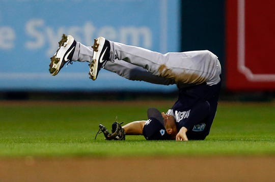 Mar 9, 2019; Sarasota, FL, USA; New York Yankees second baseman Tyler Wade (14) makes a catch for the out on Baltimore Orioles catcher Carlos Pérez (74) during the third inning of a game at Ed Smith Stadium.