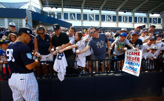 Mar 10, 2019; Tampa, FL, USA; New York Yankees right fielder Aaron Judge (99) signs autographs for fans before the start of a game against the Pittsburgh Pirates at George M. Steinbrenner Field.
