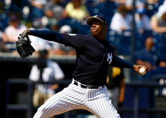 Mar 10, 2019; Tampa, FL, USA; New York Yankees relief pitcher Aroldis Chapman (54) throws a pitch during the sixth inning against the Pittsburgh Pirates at George M. Steinbrenner Field.