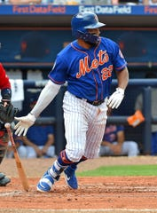 Mar 4, 2019; Port St. Lucie, FL, USA; New York Mets first baseman Dominic Smith (22) hits a single against the Boston Red Sox at First Data Field.