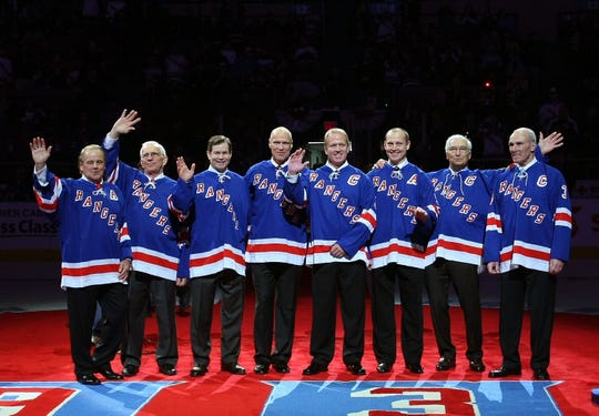 Former New York Ranger players  whose numbers have been retired join with Andy Bathgate and Harry Howell as they are given the same honor prior to the game between the Toronto Maple Leafs and the New York Rangers on February 22, 2009 at Madison Square Garden in New York City.  (L-R) are Rod Gilbert, Ed Giacomin, Mike Richter, Mark Messier, Brian Leetch, Adam Graves, Andy Bathgate and Harry Howell.
