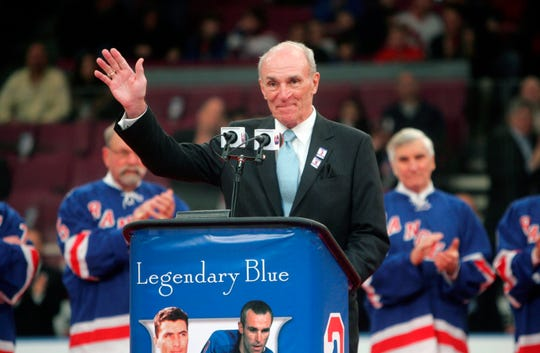 In this Sunday, Feb. 22, 2009 file photo, Harry Howell waves to the crowd during a ceremony to retire his number before the Ranger's hockey game at Madison Square Garden in New York. NHL Hall of Fame defenseman Harry Howell, who played the most games in the history of New York Rangers, has died. He was 86. Howell died Saturday night, March 9, 2019. Howell played 1,160 games for the Rangers from 1952-69 and had his No. 3 retired by the team.