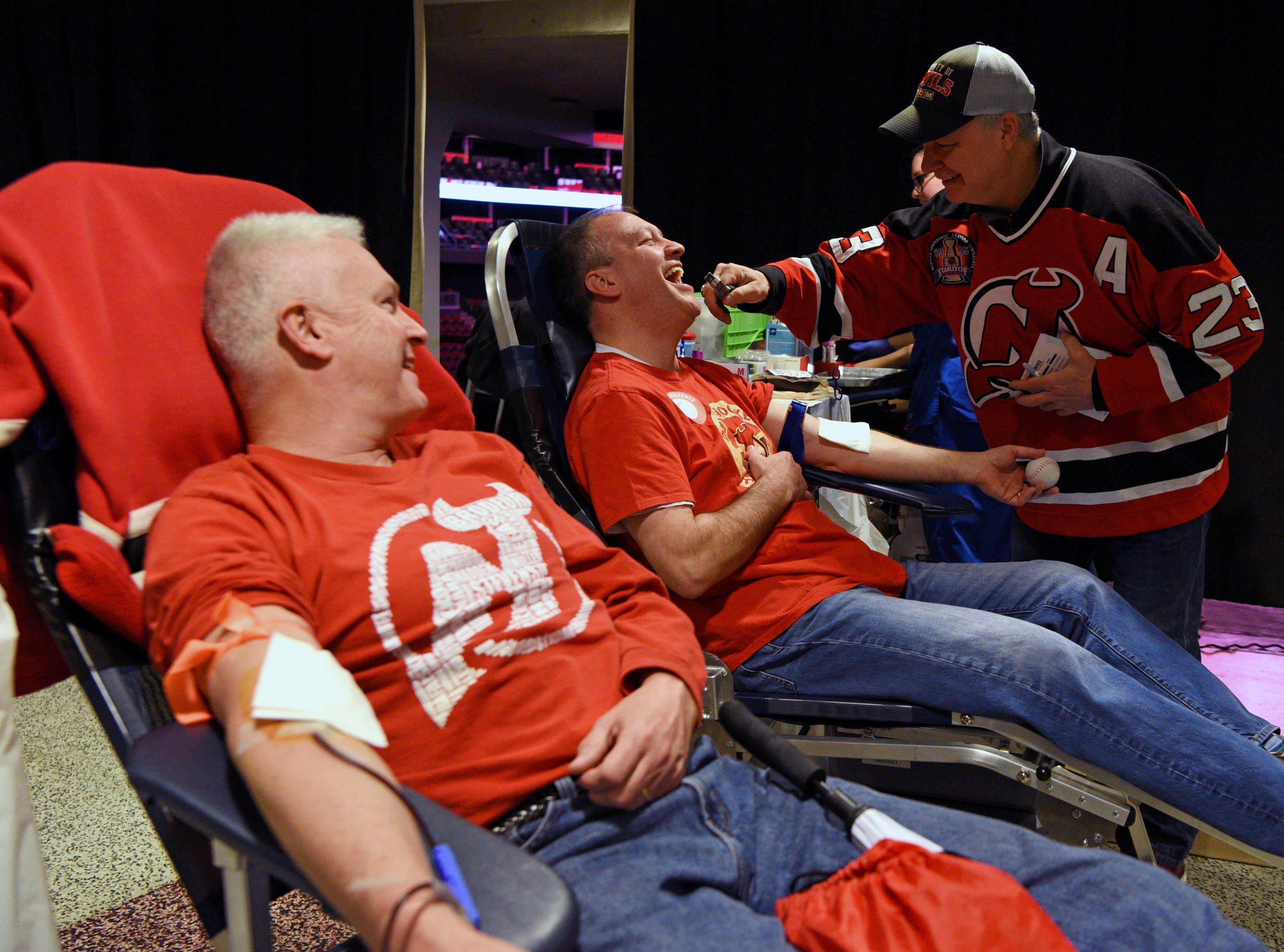 The New Jersey Devils and RWJBarnabas Health hosted their third annual blood drive in coordination with the American Red Cross on Sunday, March 10, 2019 at the Prudential Center in Newark. Devils' alumni Bruce Driver, a member of the 1995 Devils Stanley Cup winning team, pretends to pull a tooth from Jim Leonard of Branch Brook, while he donates blood.