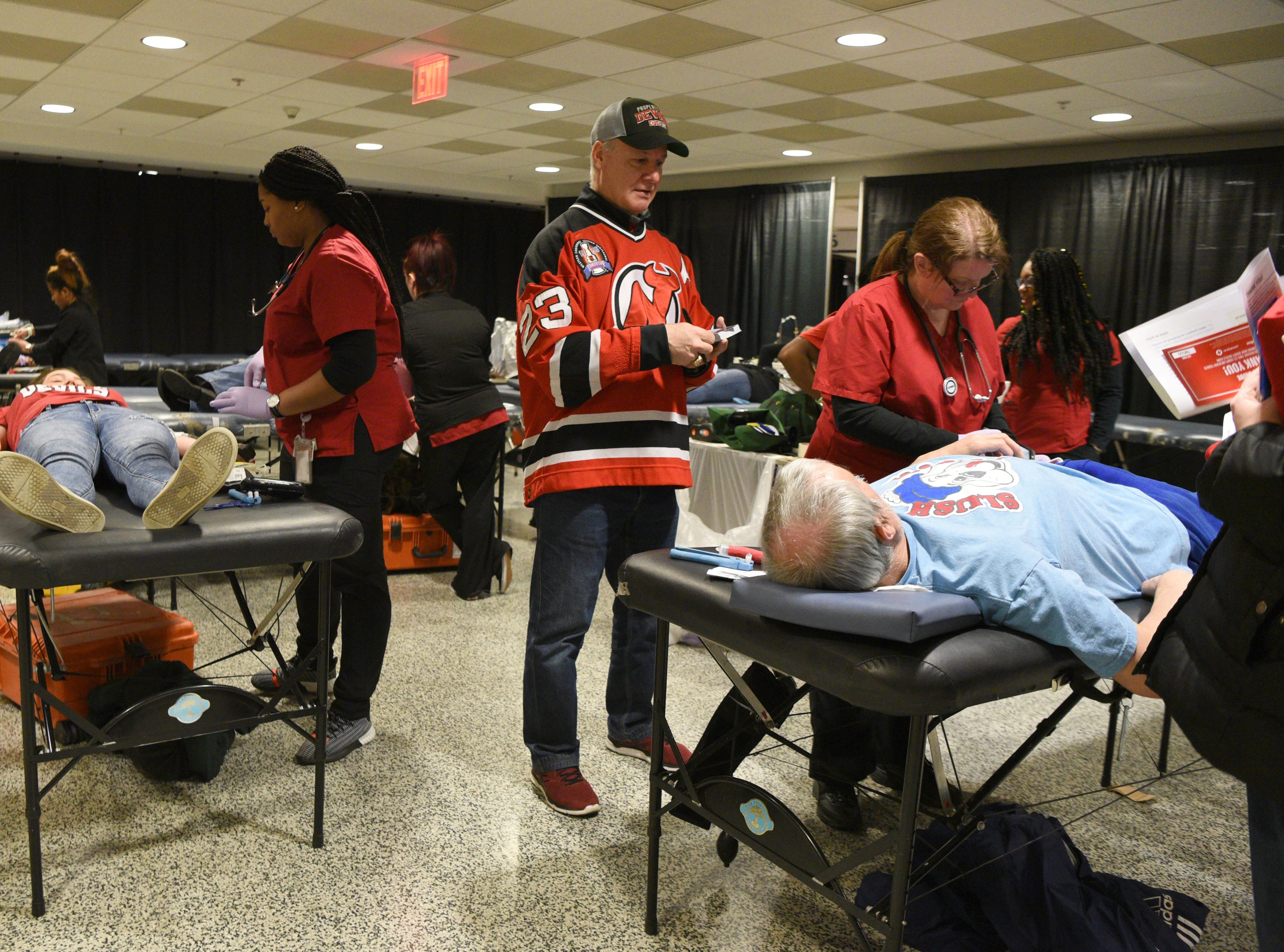The New Jersey Devils and RWJBarnabas Health hosted their third annual blood drive in coordination with the American Red Cross on Sunday, March 10, 2019 at the Prudential Center in Newark.  Devils' alumni Bruce Driver, a member of the 1995 Devils Stanley Cup winning team, talks with a blood donor.