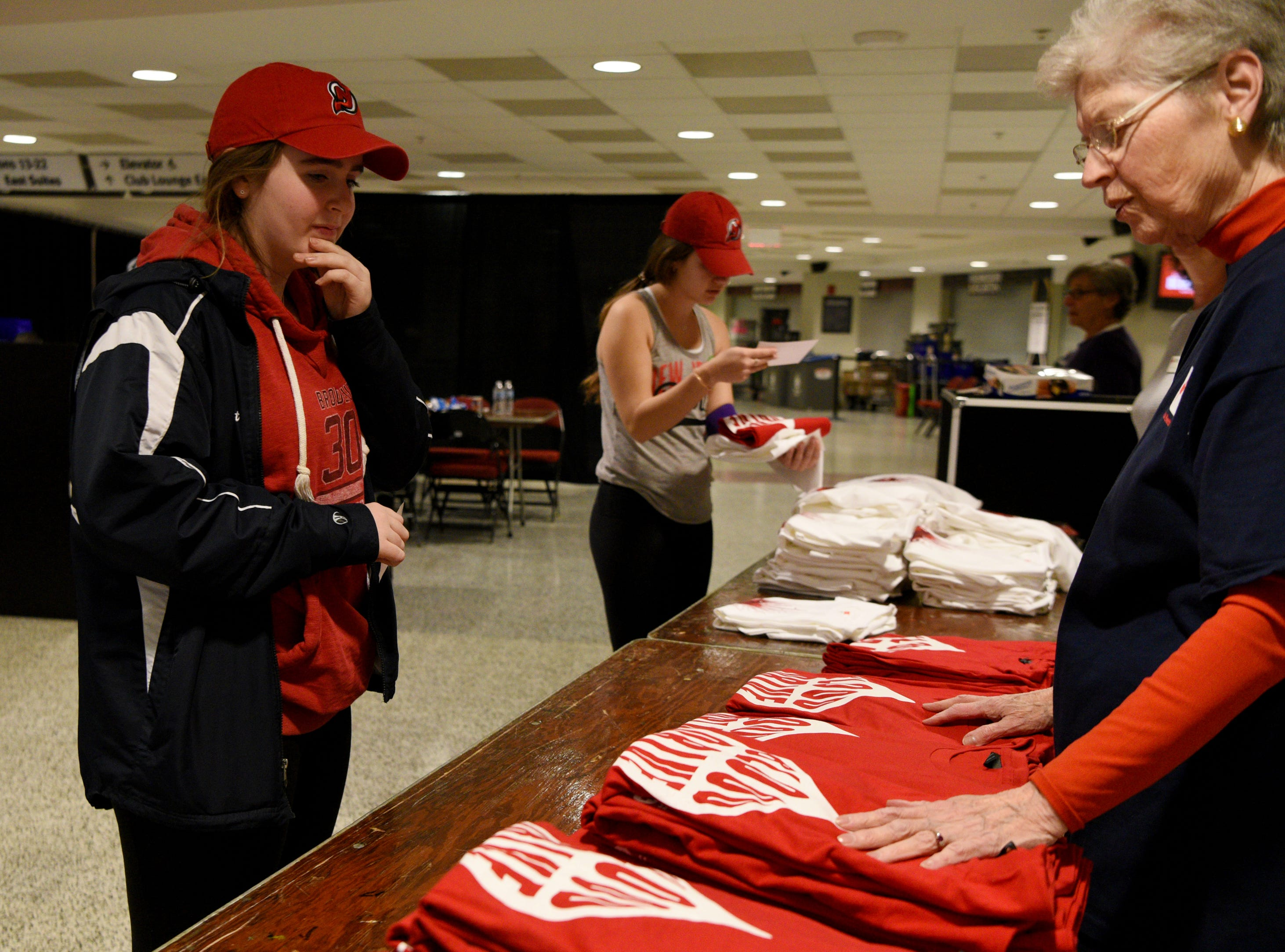 The New Jersey Devils and RWJBarnabas Health hosted their third annual blood drive in coordination with the American Red Cross on Sunday, March 10, 2019 at the Prudential Center in Newark. Bridget Clarke and Lily Krok of Freehold, pick up their free t-shirts and vouchers for Devils tickets after donating blood.