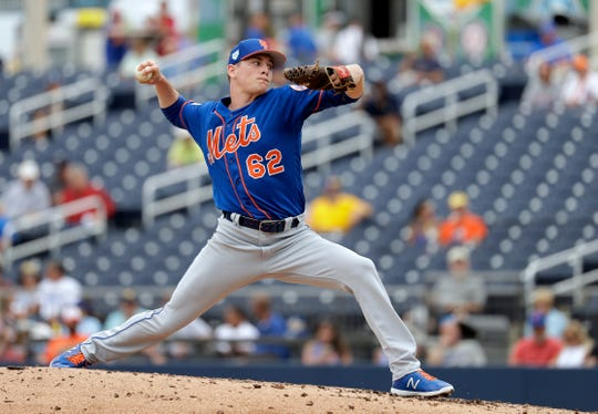 New York Mets pitcher Drew Smith throws during the third inning of an exhibition spring training baseball game against the Houston Astros Monday, Feb. 25, 2019, in West Palm Beach, Fla.