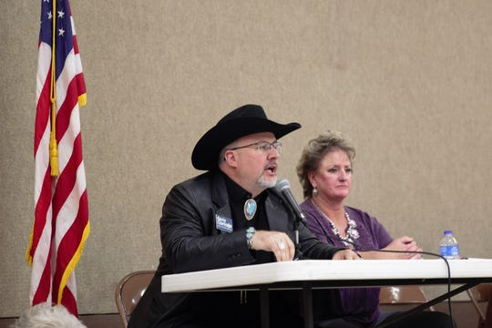 Gavin Clarkson, left, the Republican candidate for New Mexico's Secretary of State in 2018, spoke at a border security town hall in Deming on Saturday, March 9, 2019. At right is Teresa Johnson, a third-generation rancher in Luna County.