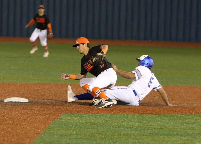 Trey Castaneda safely slides into second base for a steal against Artesia.