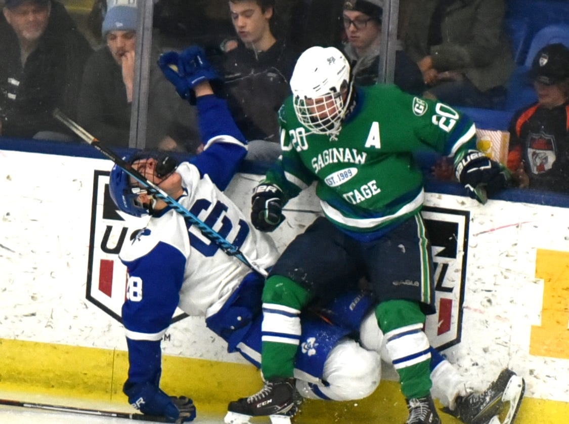 CC's Ryan Marra, left, was very unhappy with this check into the boards by Saginaw's Eddie Symons - which left him hobbled for a bit.