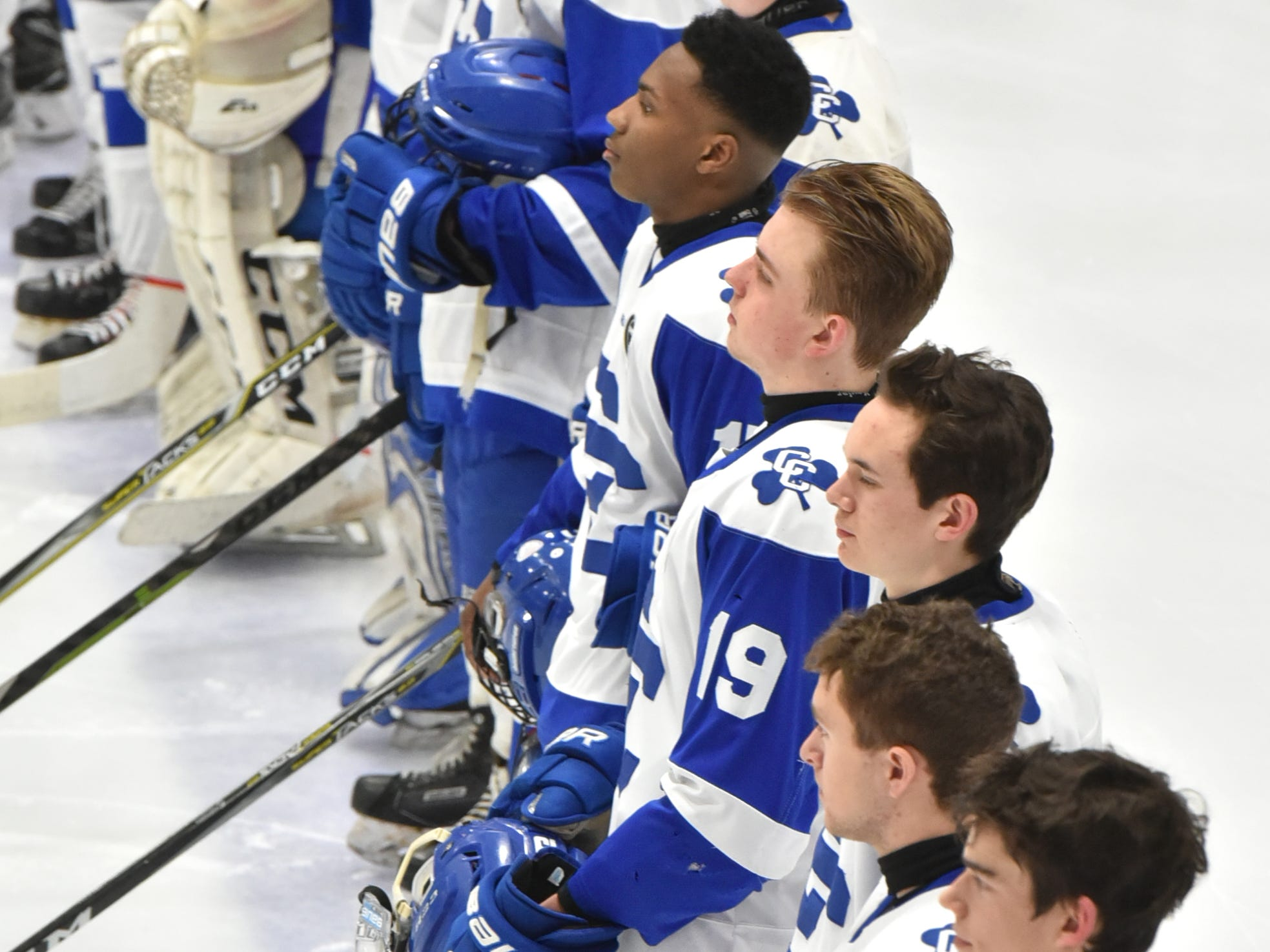 The Detroit Catholic Central hockey team stands at attention for the playing of the National Anthem at the start of their MHSAA Div. 1 state championship game against Saginaw Heritage at the USA Hockey Arena in Plymouth on March 9.