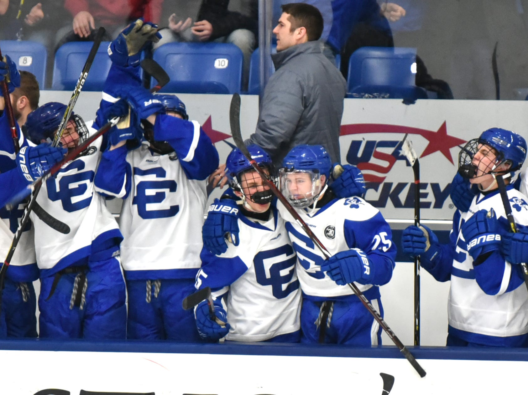 After their on-ice teammates added an empty-netter, the CC bench begins to celebrate late in Saturday's game.