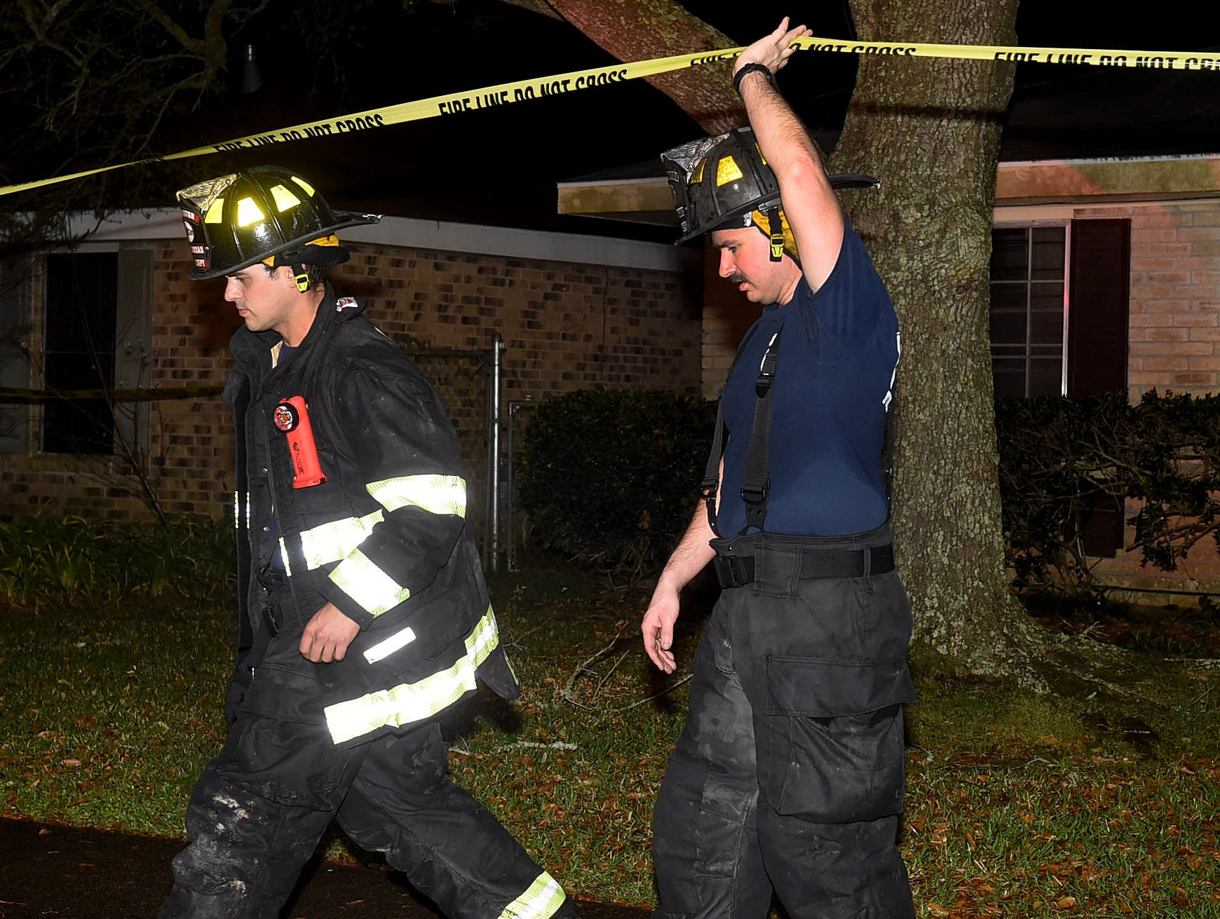 Firefighters and first responders at the scene of a Jake Drive house fire that claimed the life of one person early Sunday.