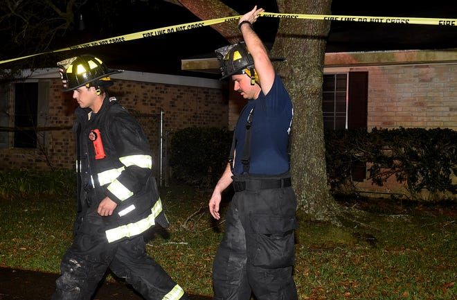Opelousas firefighters and first responders work the scene of a house fire on Jake Drive in 2019. Fire Chief Charles Mason is asking the city to consider adding $2 an hour to firefighters' base pay in order to compete with other municipal departments in St. Landry and Lafayette parishes.
