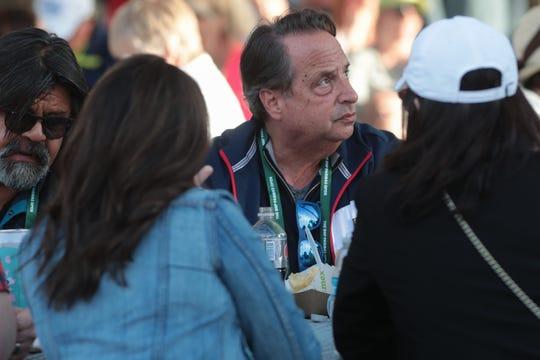 Actor Jon Lovitz watches the Venus Williams, Petra Kvitova match from the food village at the Indian Wells Tennis Garden on Saturday.