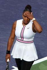 Serena Williams reacts during her match against Garbine Muguruza during the BNP Paribas Open in Indian Wells on Sunday, March 10, 2019.