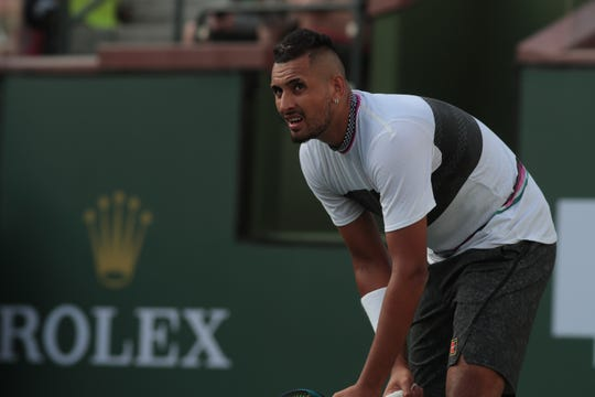 Nick Kyrgios watches the replay of a point from his match against Philipp Kohlschreiber at the BNP Paribas Open, Indian Wells, Calif., March 9, 2019.