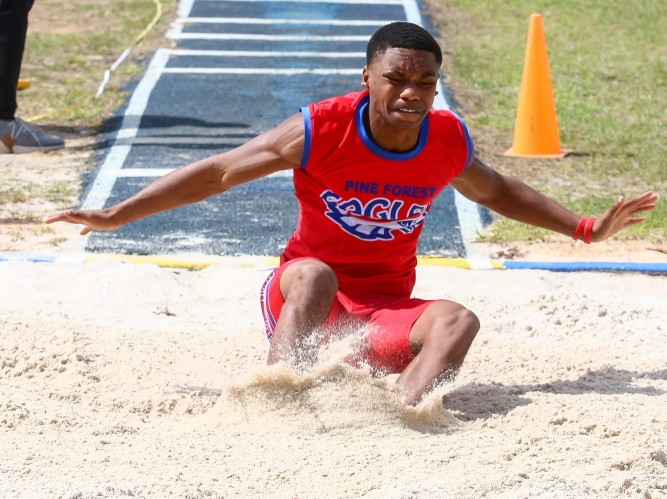 Pine Forest's Rondale Weaden competes in the long jump on Saturday, March 9, 2019, during the Aggie Invitational at Washington High School.
