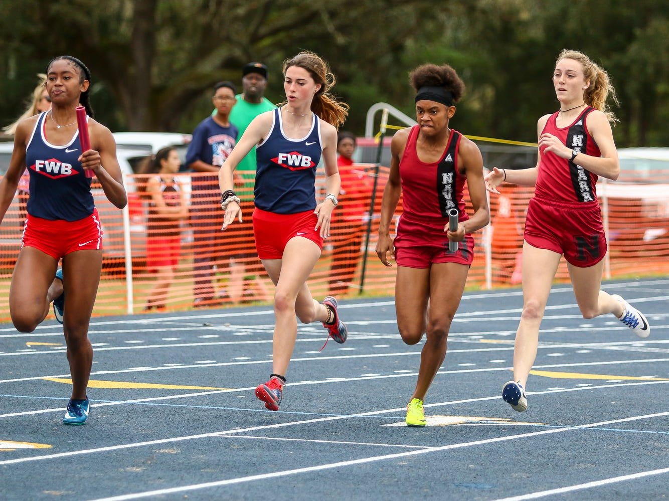 Athletes compete in the 4x100m relay on Saturday, March 9, 2019, during the Aggie Invitational at Washington High School.