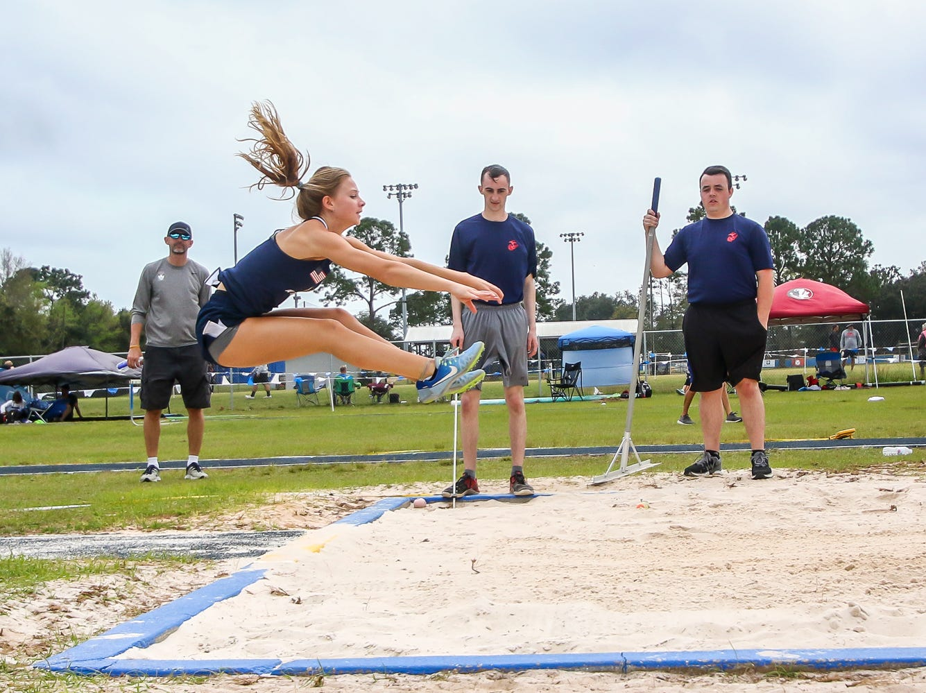 Athletes compete in the triple jump on Saturday, March 9, 2019, during the Aggie Invitational at Washington High School.