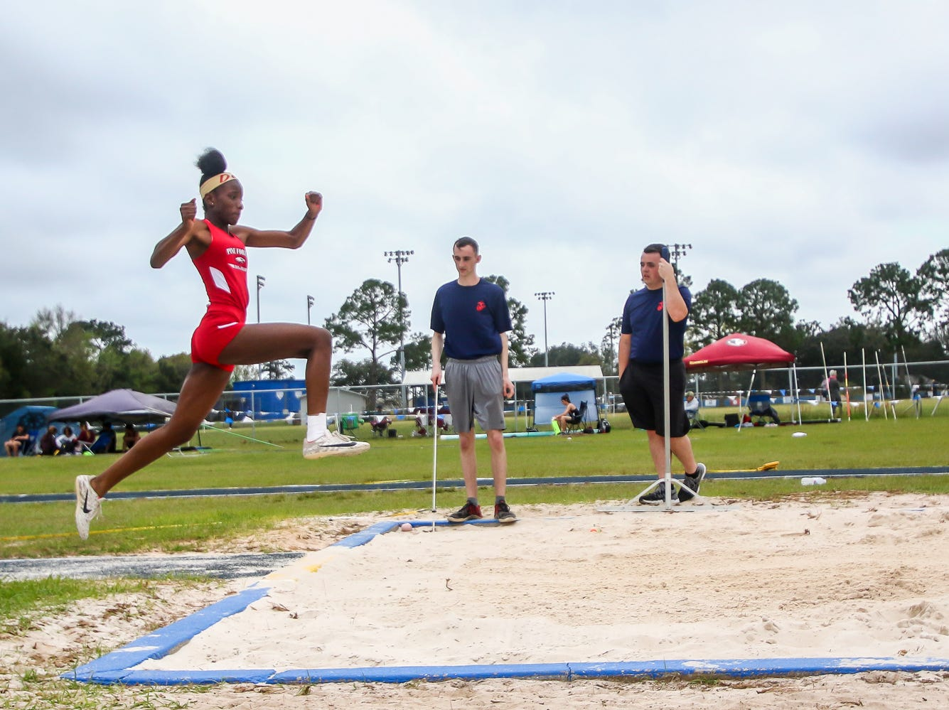 Pine Forest's Za'isha Fraser competes in the triple jump on Saturday, March 9, 2019, during the Aggie Invitational at Washington High School.