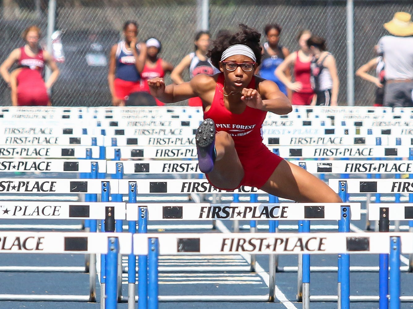 Pine Forest's Kori Arrington competes in the 100m hurdles on Saturday, March 9, 2019, during the Aggie Invitational at Washington High School.