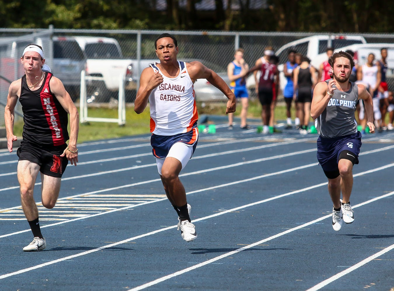 Athletes compete in the 100m dash on Saturday, March 9, 2019, during the Aggie Invitational at Washington High School.