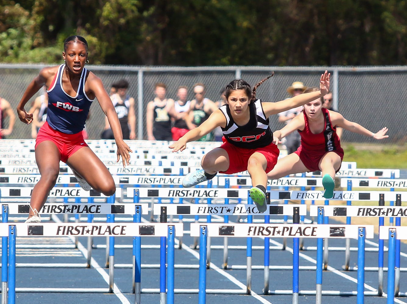Athletes compete in the 100m hurdles on Saturday, March 9, 2019, during the Aggie Invitational at Washington High School.