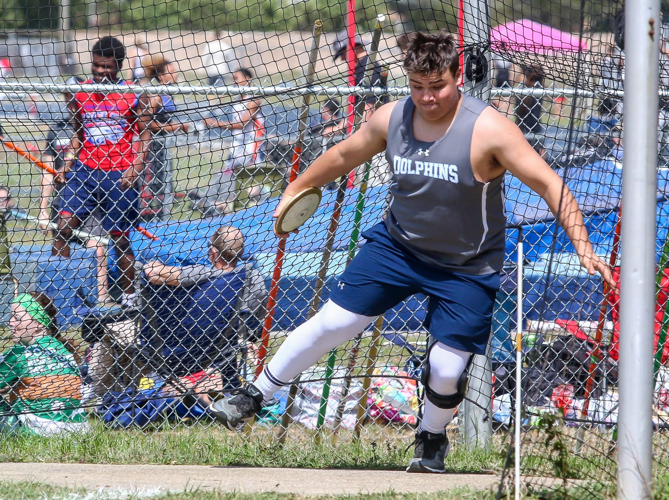Gulf Shores' Cole Jennings competes in the discus throw on Saturday, March 9, 2019, during the Aggie Invitational at Washington High School.