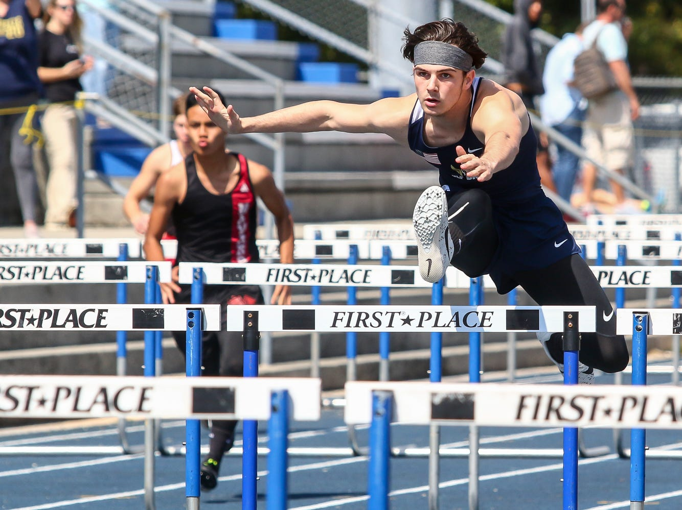 Athletes compete in the 110m hurdles on Saturday, March 9, 2019, during the Aggie Invitational at Washington High School.