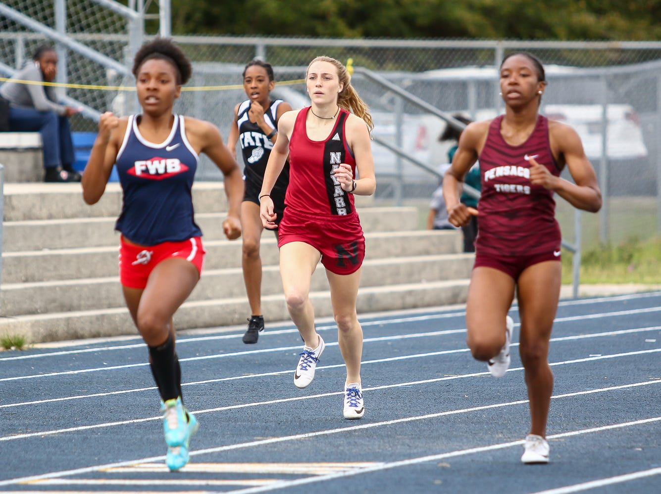 Athletes compete in the 400m dash on Saturday, March 9, 2019, during the Aggie Invitational at Washington High School.