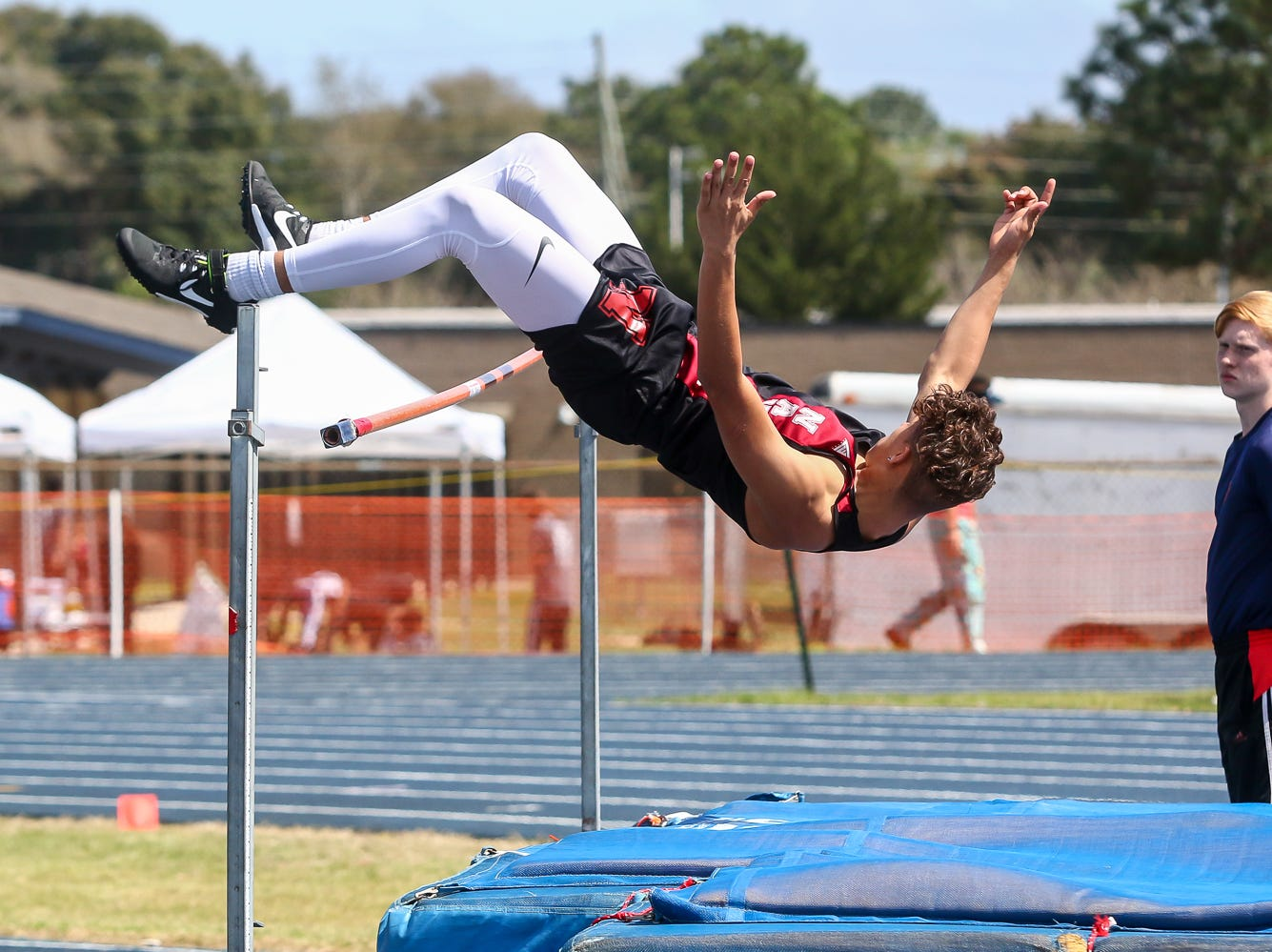 Navarre's Caden Howard competes in the high jump on Saturday, March 9, 2019, during the Aggie Invitational at Washington High School.