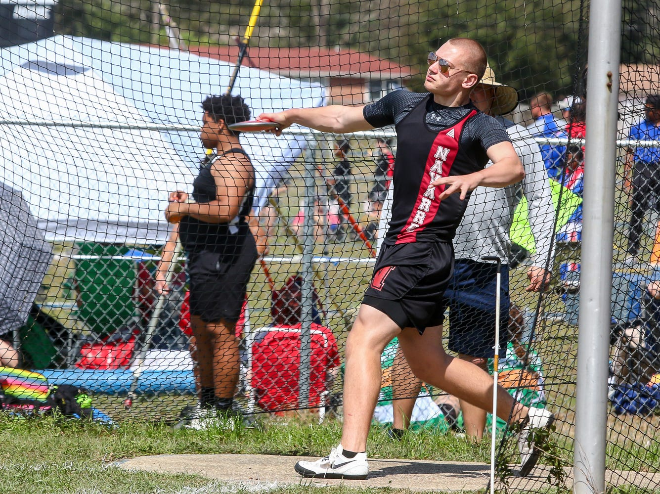 Navarre's Brandon Wangerin competes in the discus throw on Saturday, March 9, 2019, during the Aggie Invitational at Washington High School.