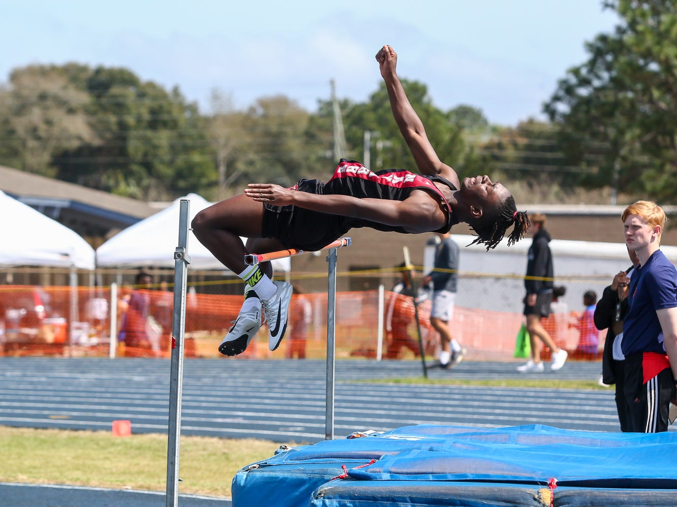 Athletes compete in the high jump on Saturday, March 9, 2019, during the Aggie Invitational at Washington High School.