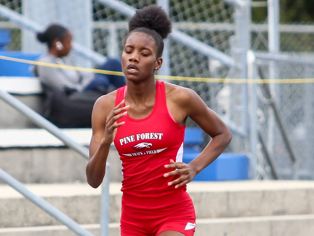 Pine Forest's Za'isha Fraser competes in the 400m dash on Saturday, March 9, 2019, during the Aggie Invitational at Washington High School.