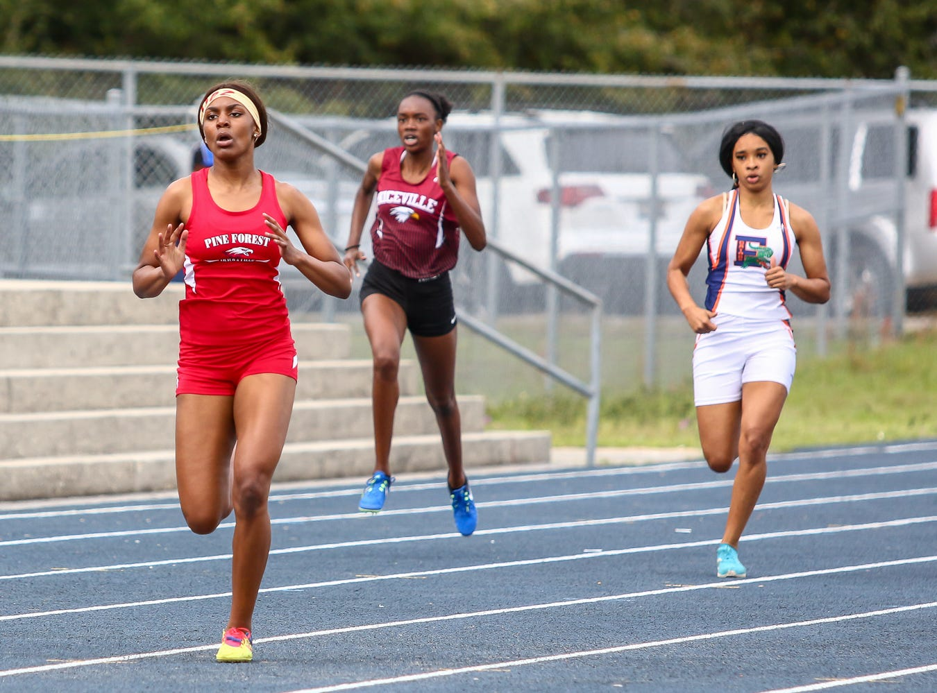 Pine Forest's Desirae McCants competes in the 400m dash on Saturday, March 9, 2019, during the Aggie Invitational at Washington High School.