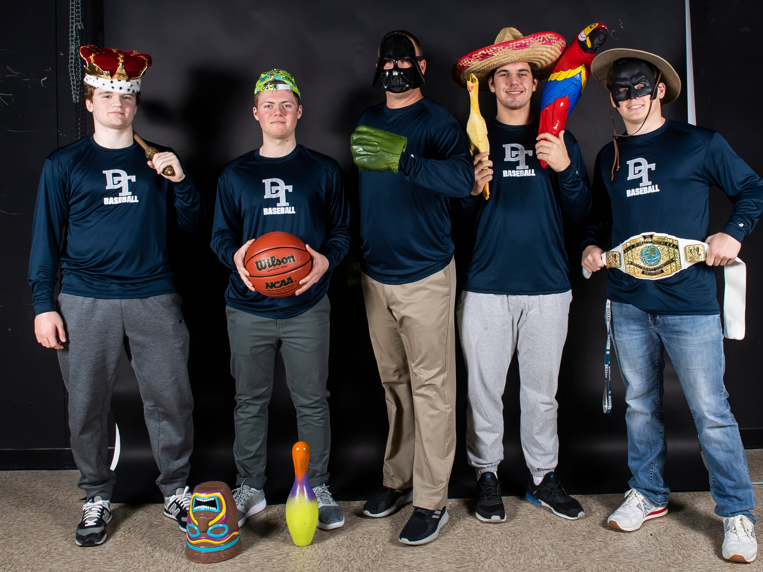 (From left) Dallastown baseball's Chase Hoecke, Alex Weakland, coach Greg Kinneman, Peter Capobianco and Julian Bailey strike a pose in the GameTimePA photo booth during spring sports media day in York Sunday, March 10, 2019.