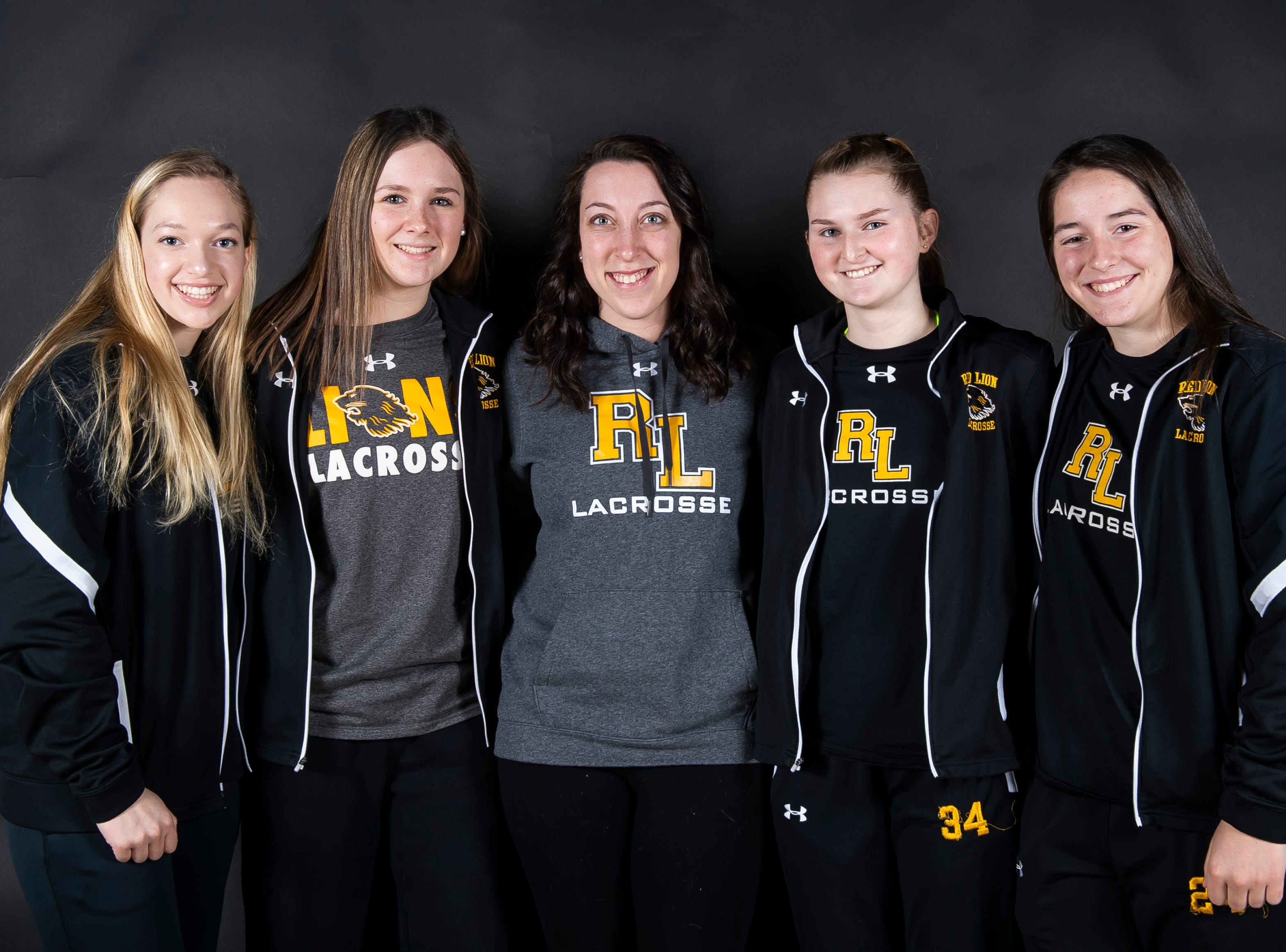 (From left) Red Lion lacrosse's Chloe Vega, Brittany Baker, coach Megan Luckenbaugh, Allie Dettinger and Courtney Cleary pose in the GameTimePA photo booth during spring sports media day in York Sunday, March 10, 2019.