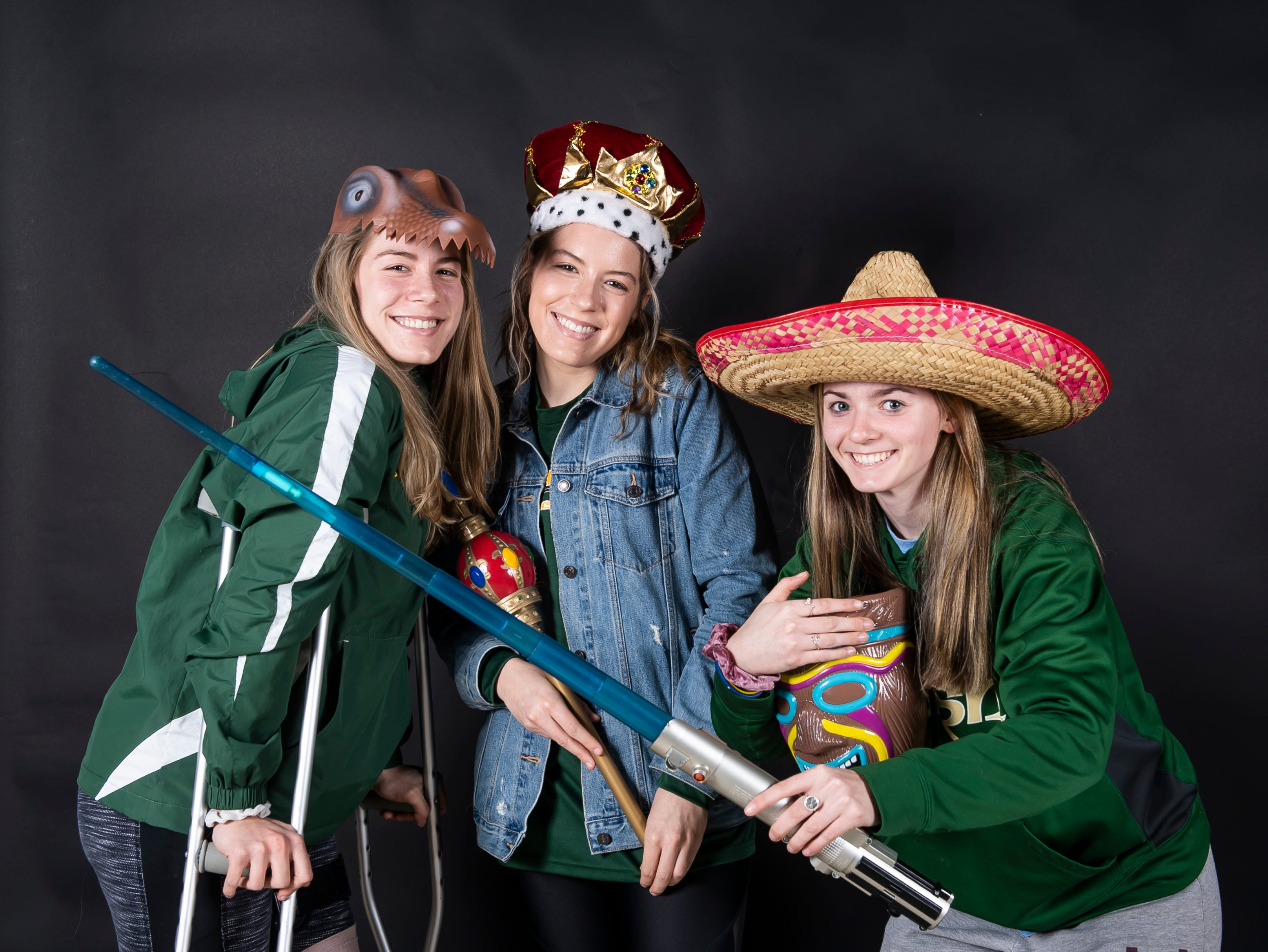(From left) York Catholic lacrosse players Sarah Reed, Grace Reed and Phallon Kilduff strike a pose in the GameTimePA photo booth during spring sports media day in York Sunday, March 10, 2019.