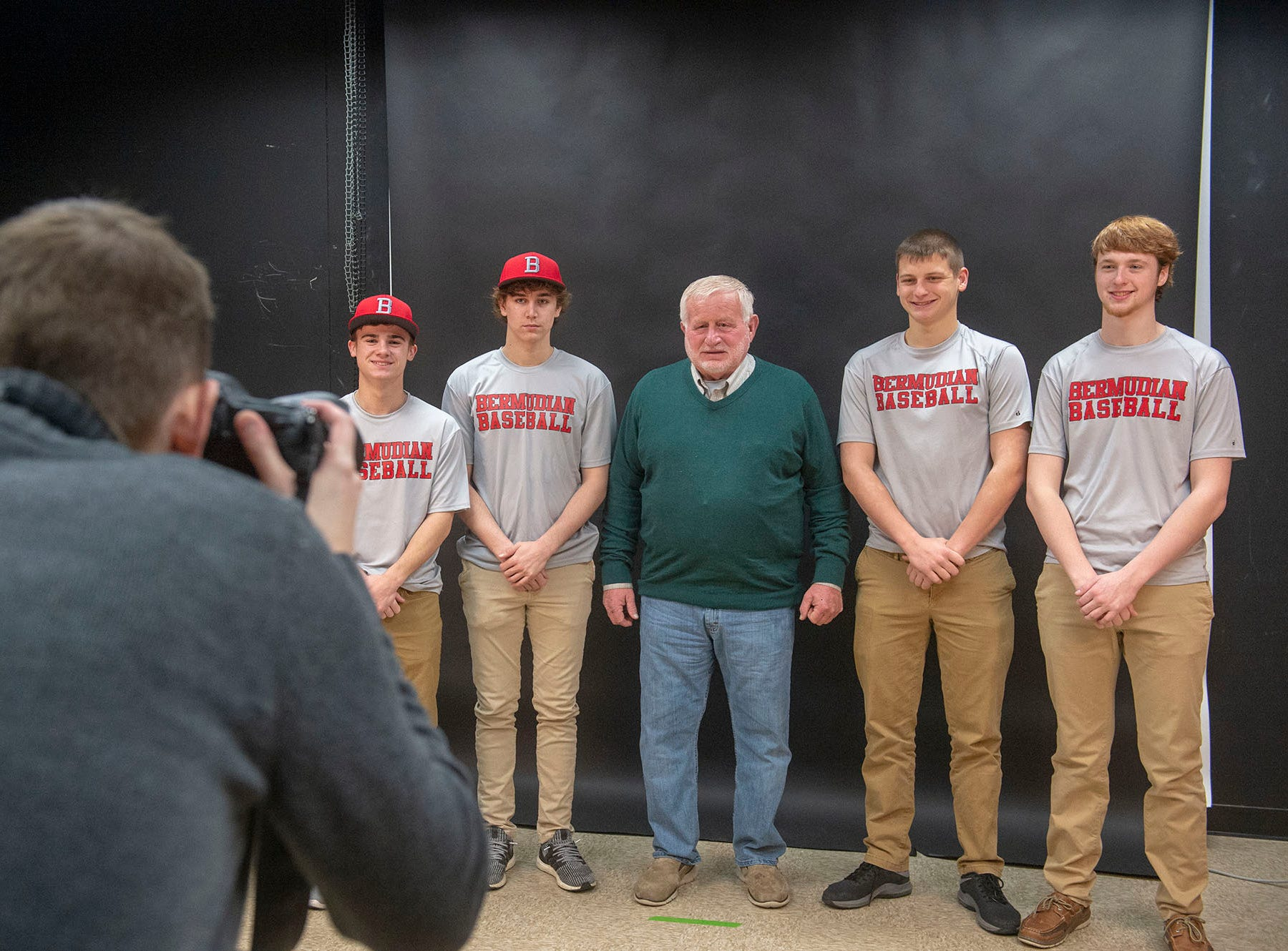 Bermudian Springs baseball players and coach Bruce Reinert get their photo taken by Dan Rainville at GameTimePA's Spring Media Day at the York Daily Record on Sunday, March 10, 2019.