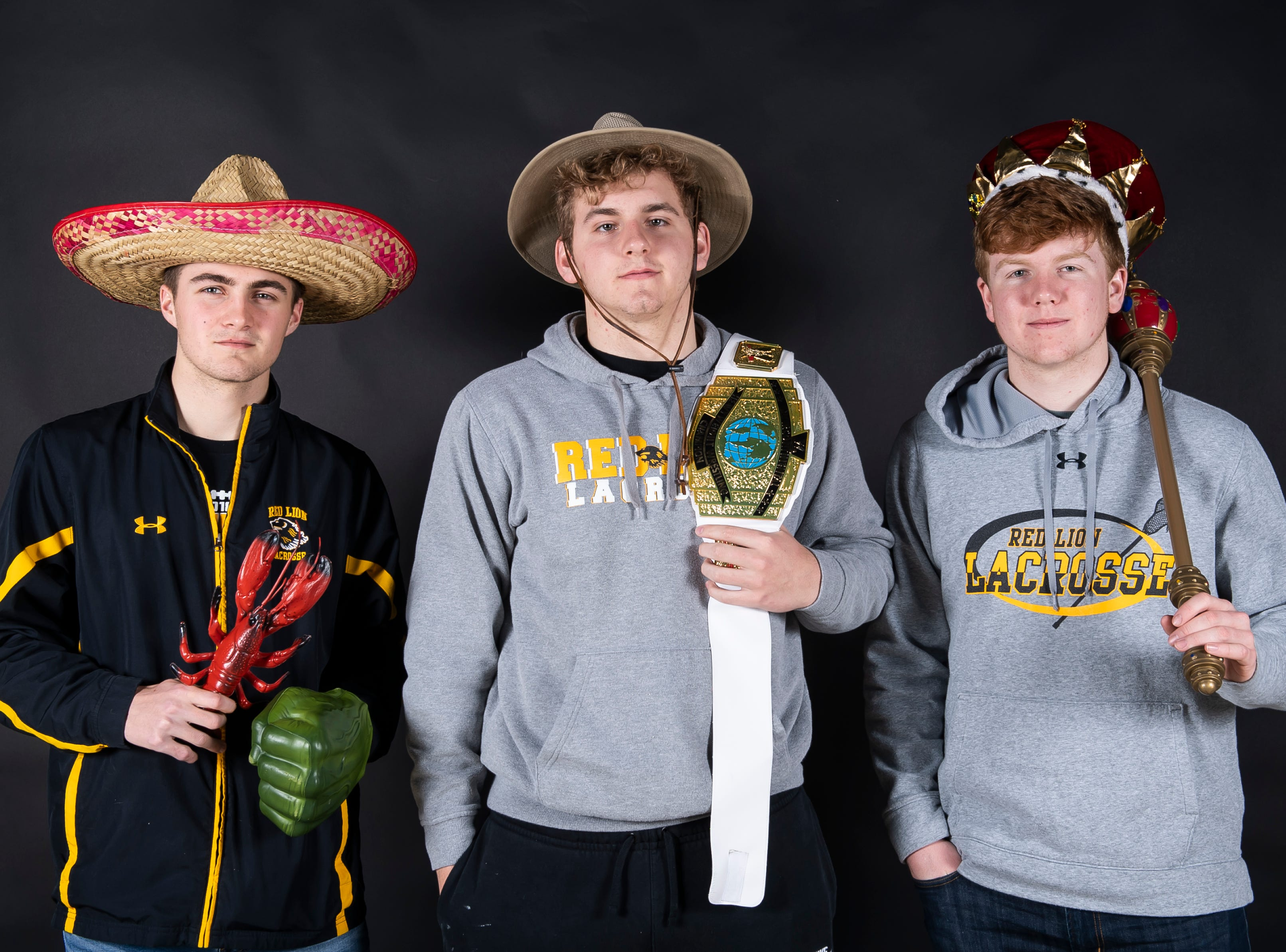 (From left) Red Lion lacrosse players Ben Hornberger, Eli Workinger and Quinn Lyons strike a pose in the GameTimePA photo booth during spring sports media day in York Sunday, March 10, 2019.