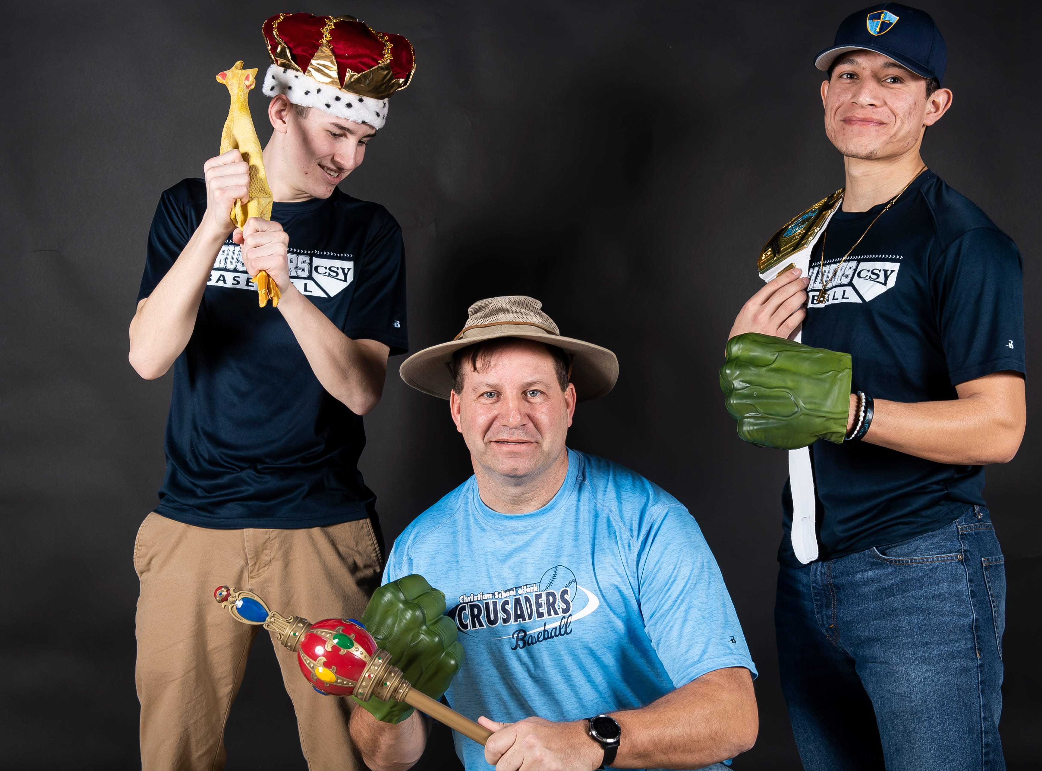 (From left) Christian School of York baseball's Lane Ferrence, coach Ed Bills and Neco Velasco strike a pose in the GameTimePA photo booth during spring sports media day in York Sunday, March 10, 2019.