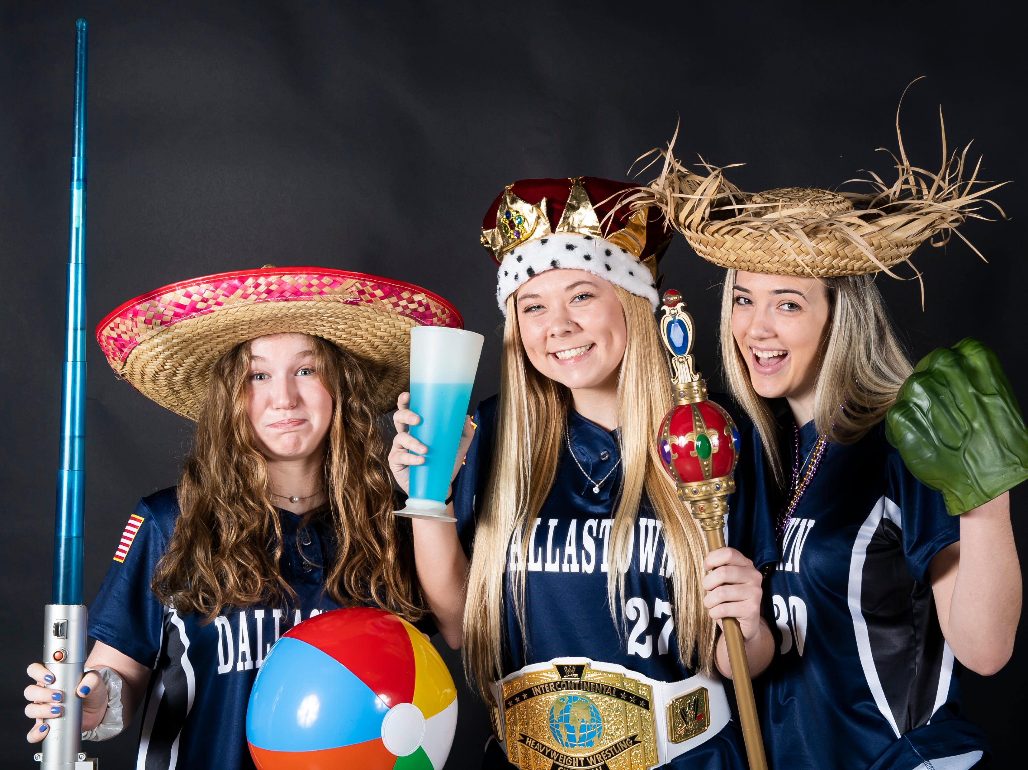 (From left) Dallastown softball players Elaina Winemiller, Kelsie Merriman and Shauna Stotler strike a pose in the GameTimePA photo booth during spring sports media day in York Sunday, March 10, 2019.