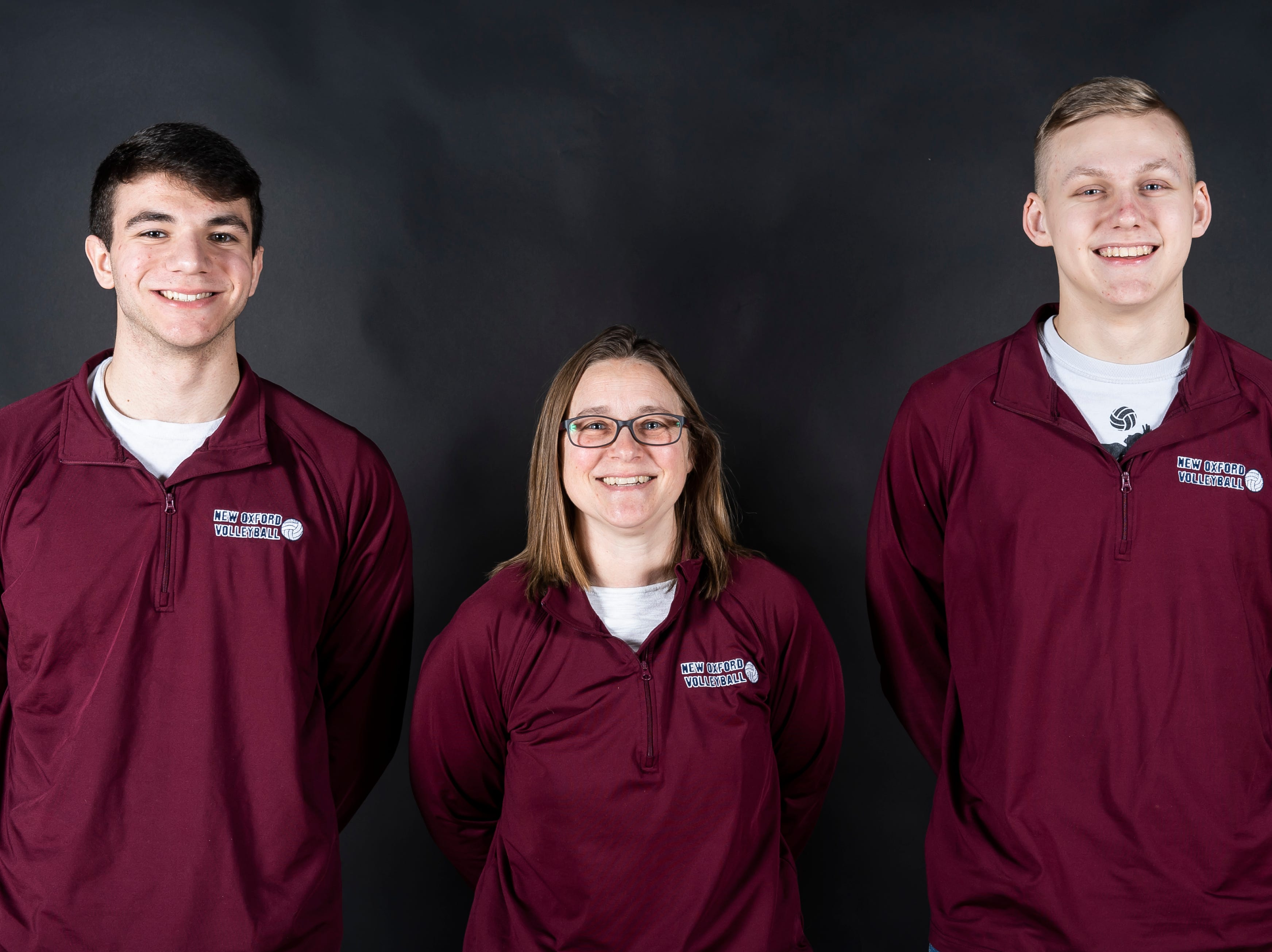 (From left) New Oxford volleyball's Matthew Faust, coach Rachel Booth and Joe Angleberger pose in the GameTimePA photo booth during spring sports media day in York Sunday, March 10, 2019.