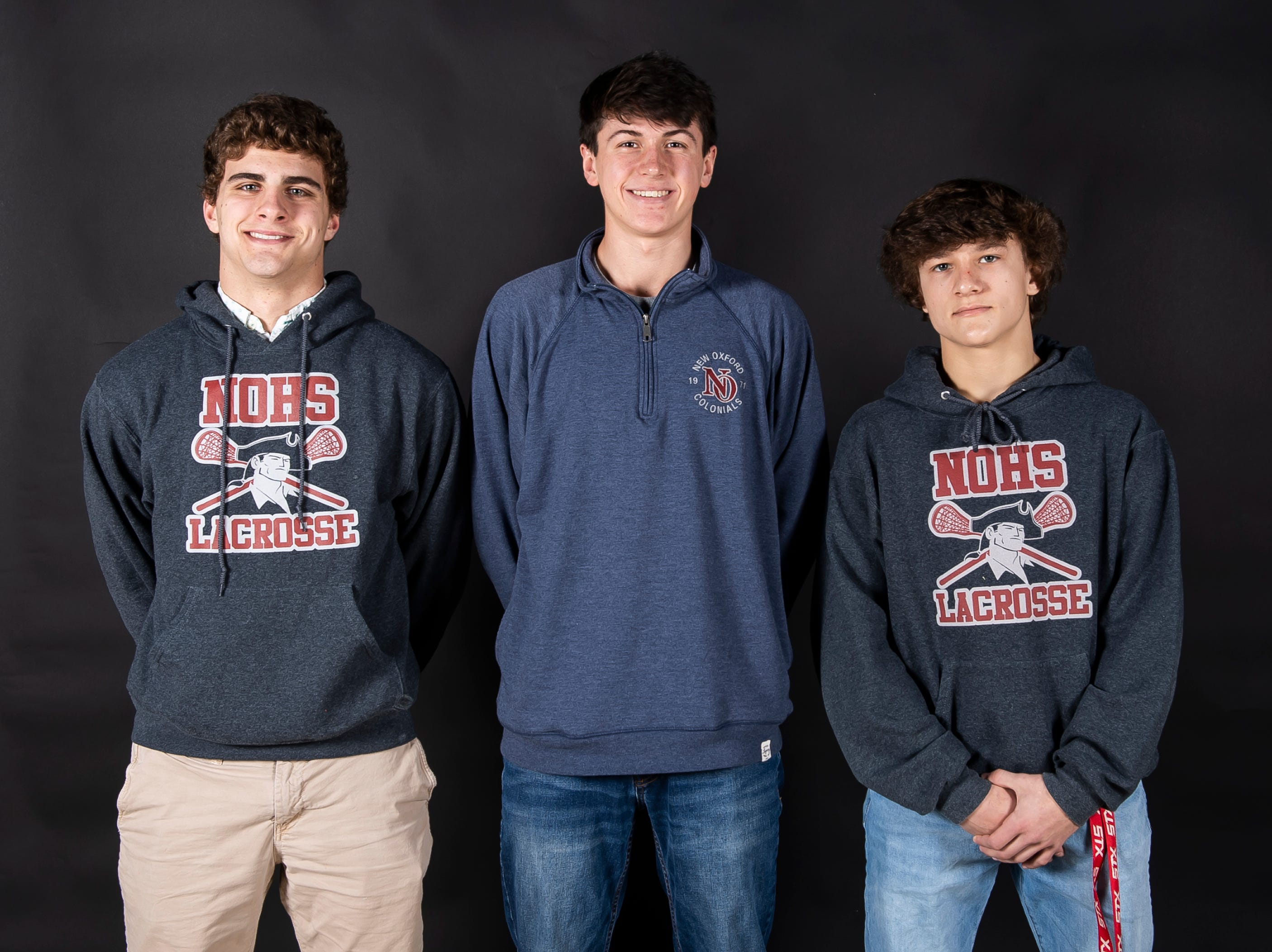 (From left) New Oxford lacrosse players Luke Laradello, Caleb Kelley and Lance Beckner pose in the GameTimePA photo booth during spring sports media day in York Sunday, March 10, 2019.