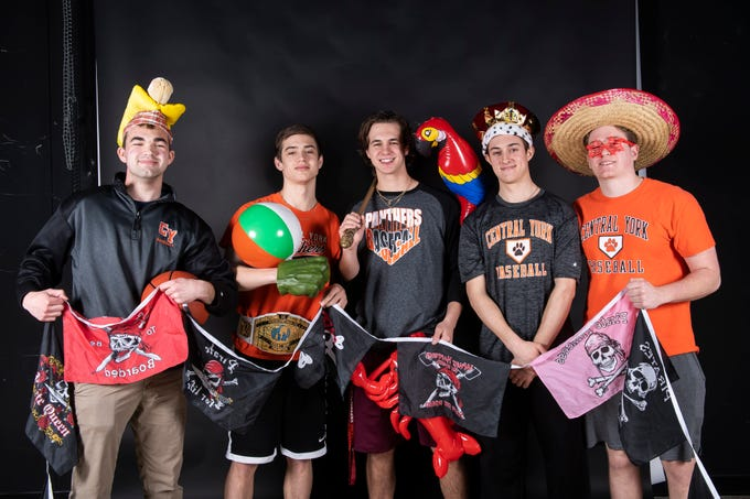 Central York baseball players strike a pose in the GameTimePA photo booth during spring sports media day in York Sunday, March 10, 2019.