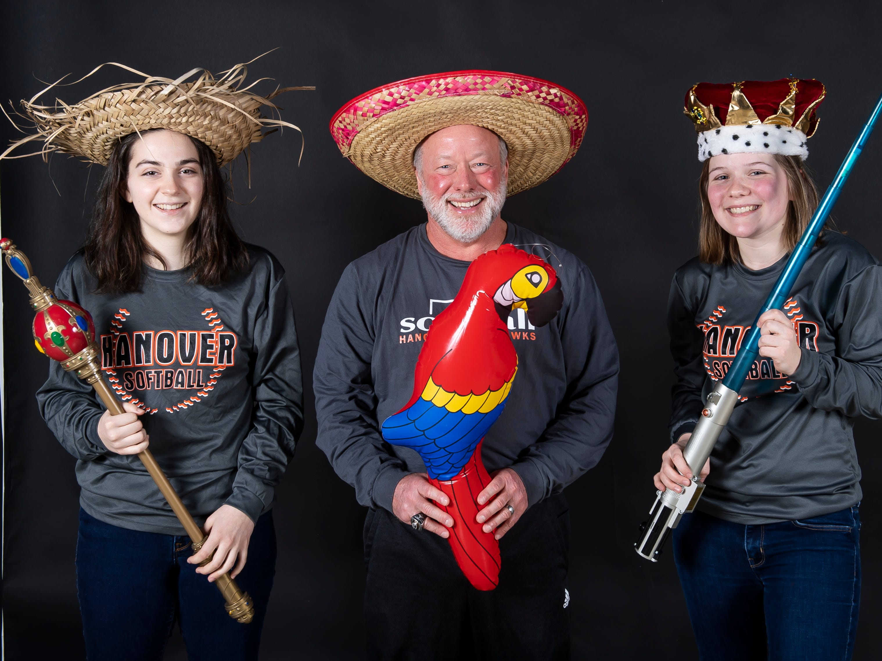 (From left) Hanover softball's Emily Hann, coach Henry Wardrop and Sierra Stevens strike a pose in the GameTimePA photo booth during spring sports media day in York Sunday, March 10, 2019.