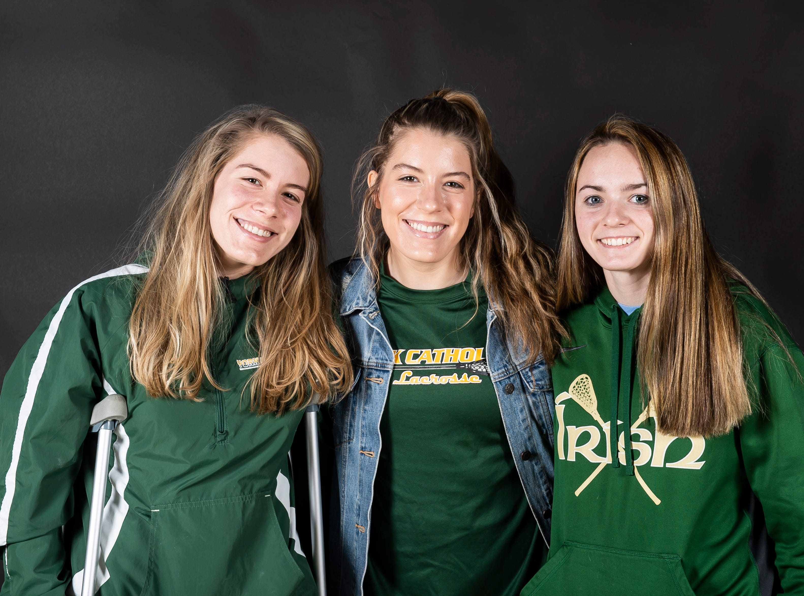 (From left) York Catholic lacrosse players Sarah Reed, Grace Reed and Phallon Kilduff pose in the GameTimePA photo booth during spring sports media day in York Sunday, March 10, 2019.