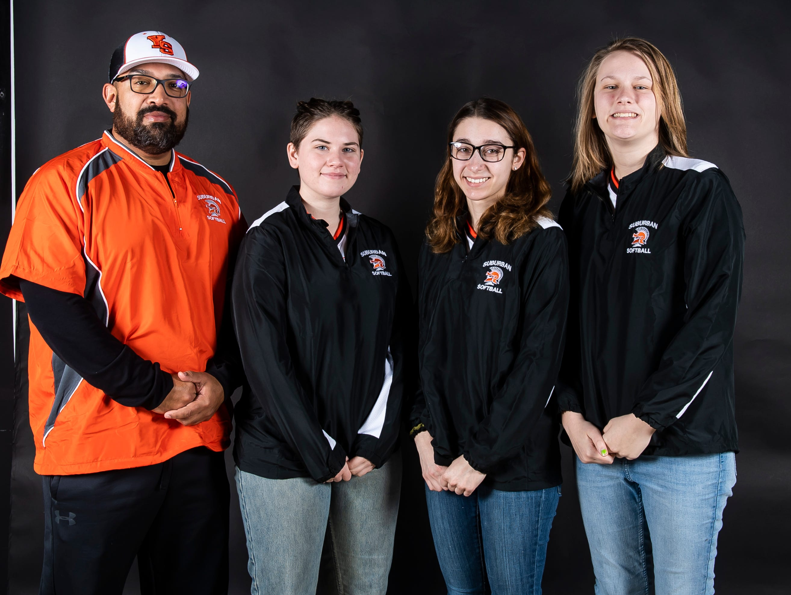 (From right) York Suburban softball players Kylie Strebig, Maddie Barshinger and Emily Myers pose with coach Larry Dalton in the GameTimePA photo booth during spring sports media day in York Sunday, March 10, 2019.