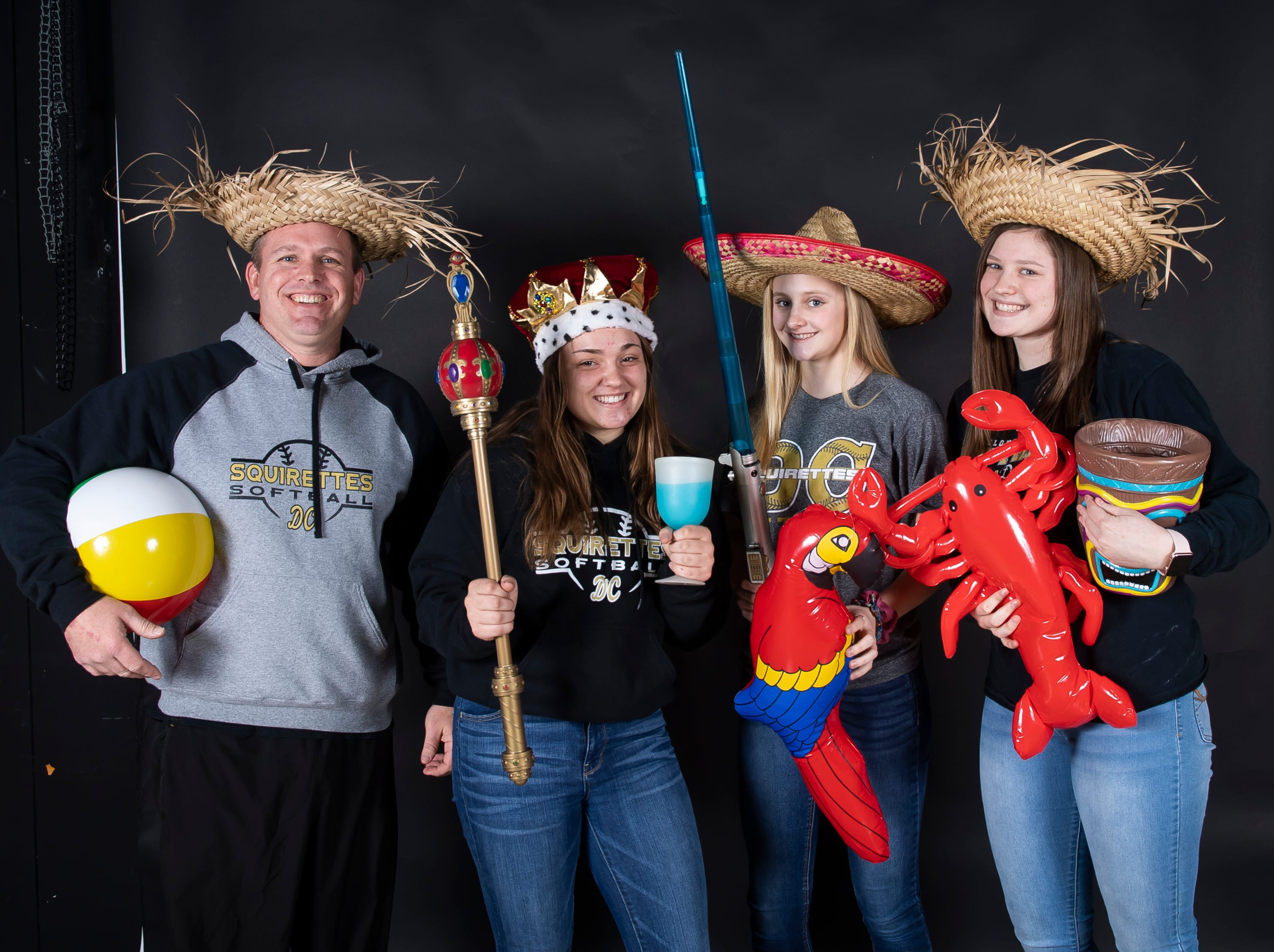 (From left) Delone Catholic softball coach Matt Rickrode and players Katie Ernst, Lauren Little and Maggie Rickrode strike a pose in the GameTimePA photo booth during spring sports media day in York Sunday, March 10, 2019.